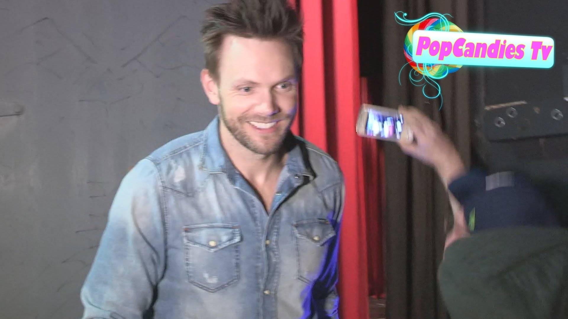 joel mchale on seattle seahawks while greeting fans at